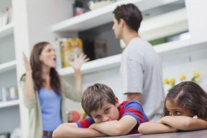 couple arguing near kids